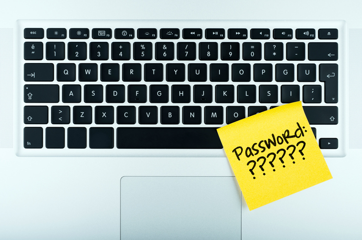 password reminder adhesive note paper on the laptop computer keyboard